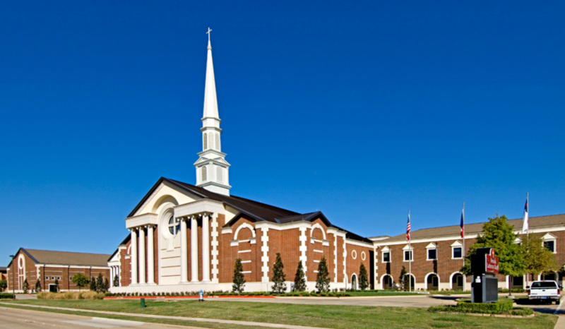 Front view of Messiah Lutheran grounds, with the center focus on the main building with tall white steeple