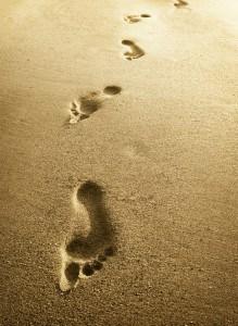 Footprints in beach sand to represent faith