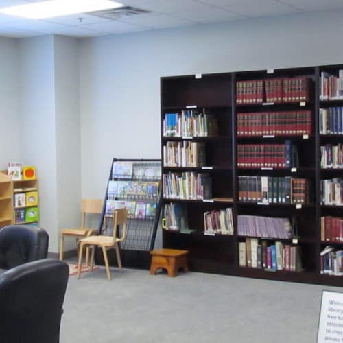 Bookcases and childrens corner in the Messiah Lutheran Library