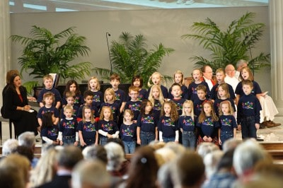 Children's choir performing for a group